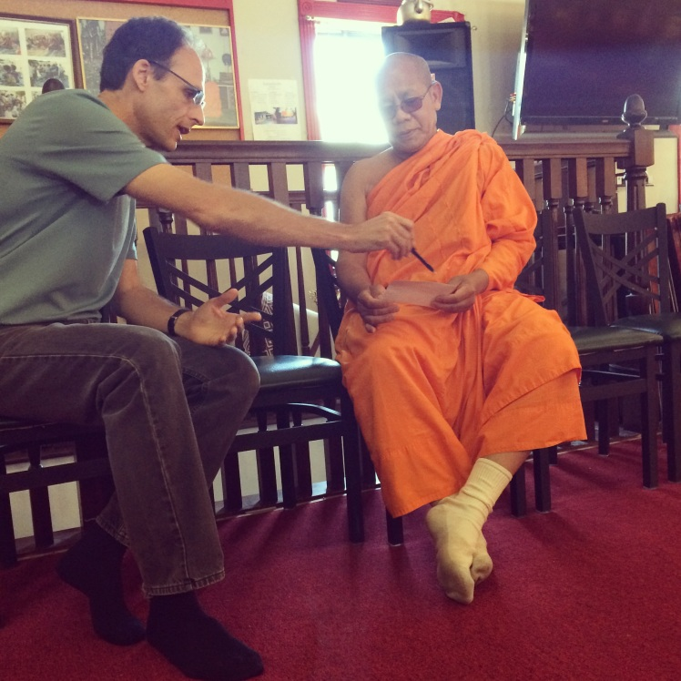 Steve P (Troy's mentor/coach) shares the gospel w head monk of local Lao Buddhist temple in Nashville.